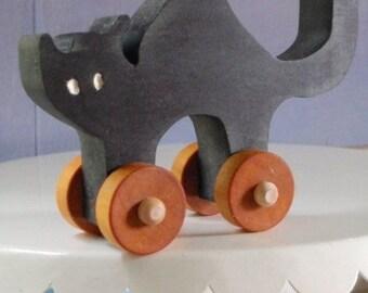 black cat folk art push toy
