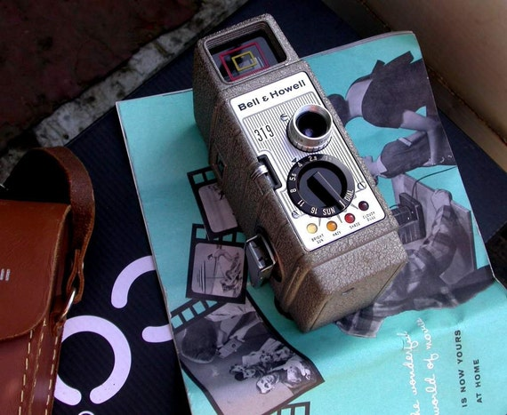 """vintage Bell and Howell  """"sundial"""" 319 movie camera, 8mm, windup"""