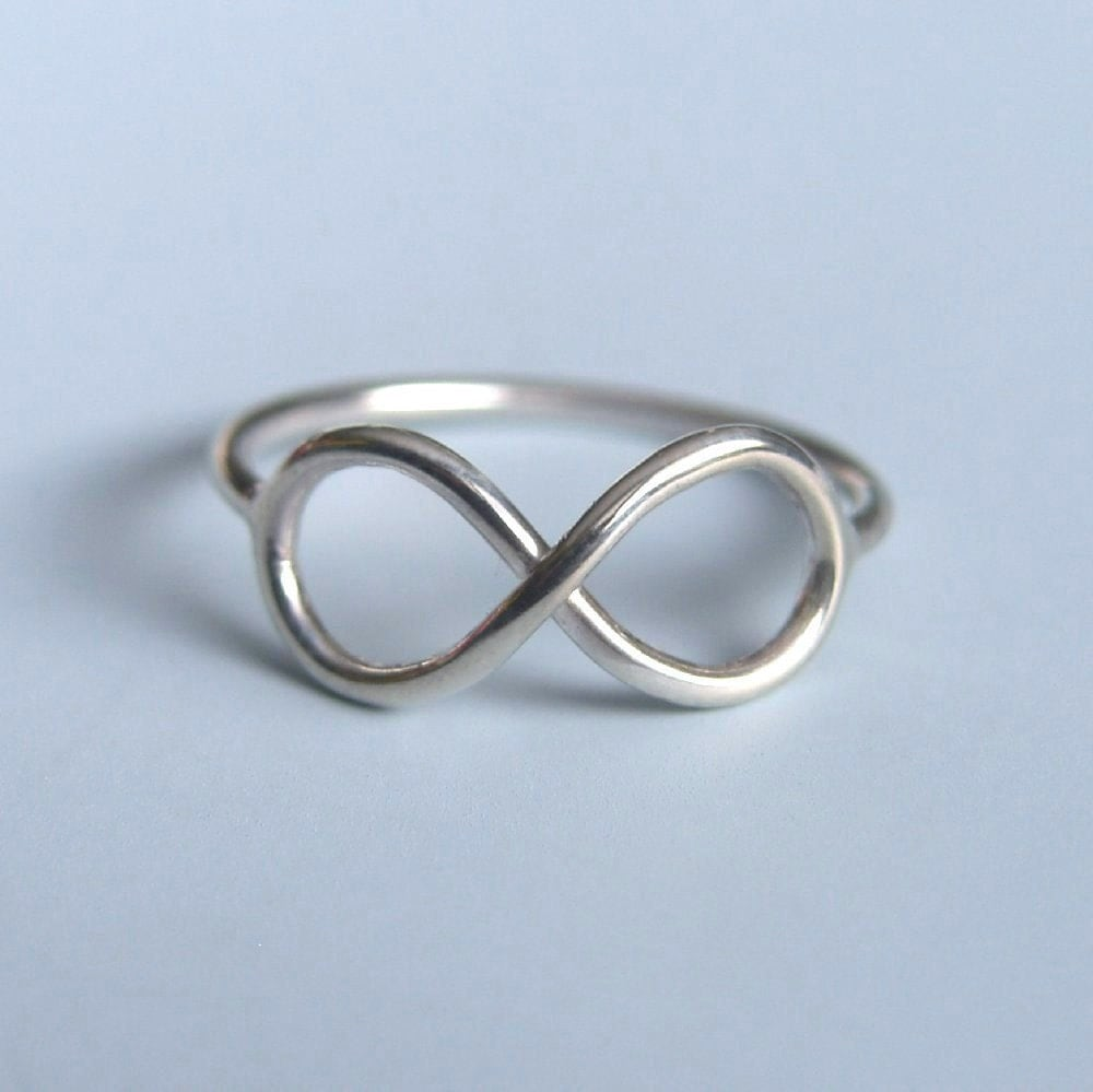 Infinity Symbol Ring Sterling Silver Infinity Ring. Native American Watches. Infinity Wedding Band. February Birthstone Necklace. Universal Time Bracelet. Two Engagement Rings. Vintage Chanel Brooch. 14 Carat Gold Bangle Bracelet. Platinum Pave Wedding Band