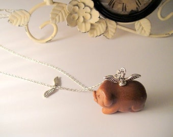 When Pigs Fly                                        (Gold Stone Carve Pig)
