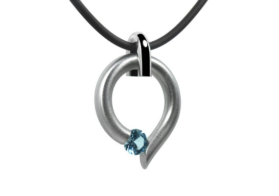 Blue Topaz Tension Set Teardrop Shaped Pendant in Stainless Steel