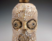 Perplexed Looking White Crackle Glazed Skull Jug with Bone-Shaped Spout and Handle