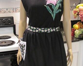 MODERN HALF APRON: Daisy Half Apron,black with a daisy print on pocket and ruffled hem