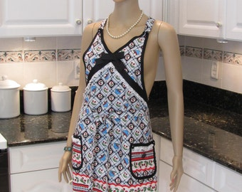 WOMAN'S,  full, apron , retro style ,sassy in a turquoise ,black and red cherry motif. ,with a dish towel included