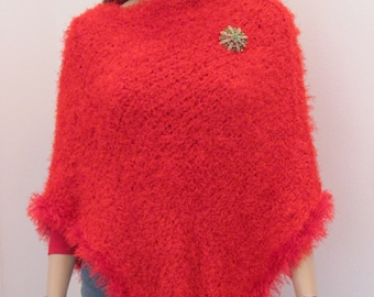 RED PONCHO,  hand knitted, double knitted in a Paton, Allure polyester yarn,fun fur trim,long in back also.