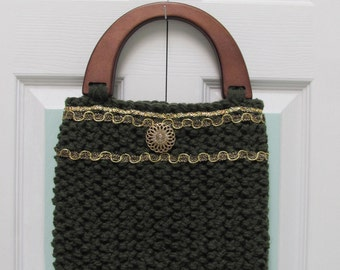DESIGNER STYLE KNIT-Handbag/purse,with brown wood handles ,hand knitted in a dk. green yarn, seed stitch pattern