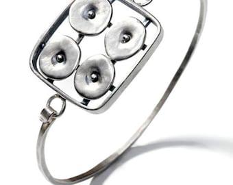 Geometrics in Motion Bangle Bracelet