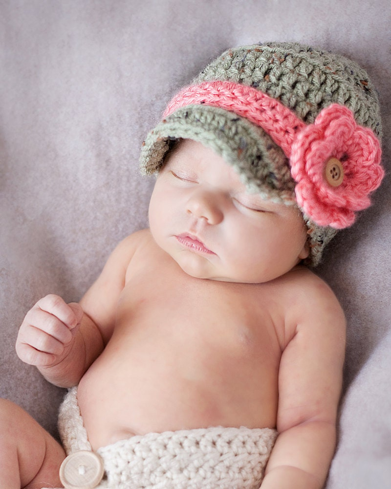 Free Crochet newsboy Hat Pattern {Newborn-3 months} Newborn-3 months Baby Newsboy FREE Crochet Pattern with Brim: This newsboy crochet cap is very easy to complete and looks great, I love how the Brim is pretty stiff by doing the Half Double Crochet and using 2 strands of yarn. Finished hat is 16 inches around ( months) I have included how.