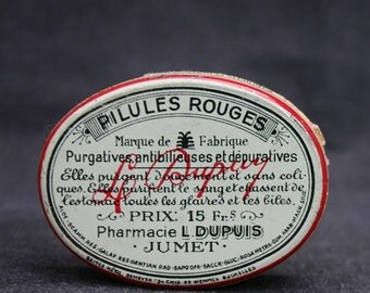 Red pills. Vintage French medicine tin box.
