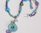 Flirt necklace, aqua blue, green and purple resin & Swarovski crystal