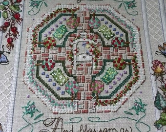 "Completed Floral Cross Stitch of Isaiah Proverb ""The desert shall rejoice..."""