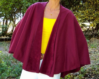 One Size fits all lightweight polar fleece shawl. Color shown in large photo is wine.  .