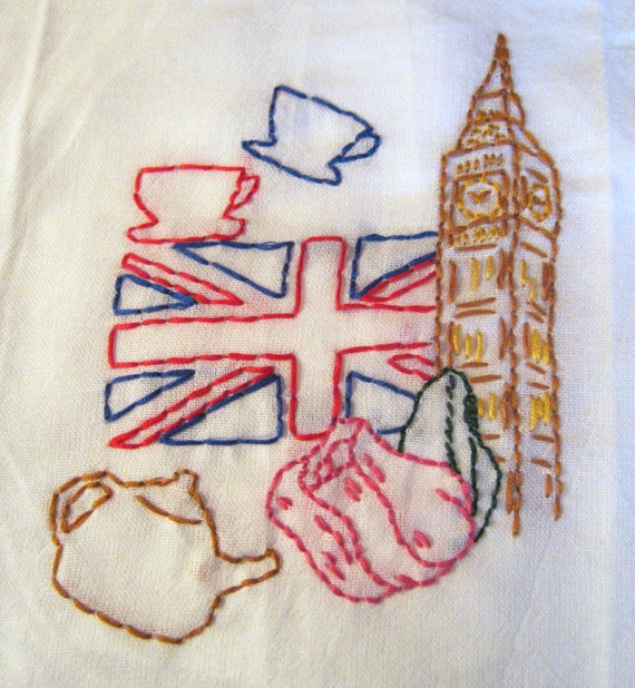 """SALE. London Calling towel, hand embroidered. Design includes all things """"London"""" -- Big Ben, Union Jack, a spot of tea, and a rose."""