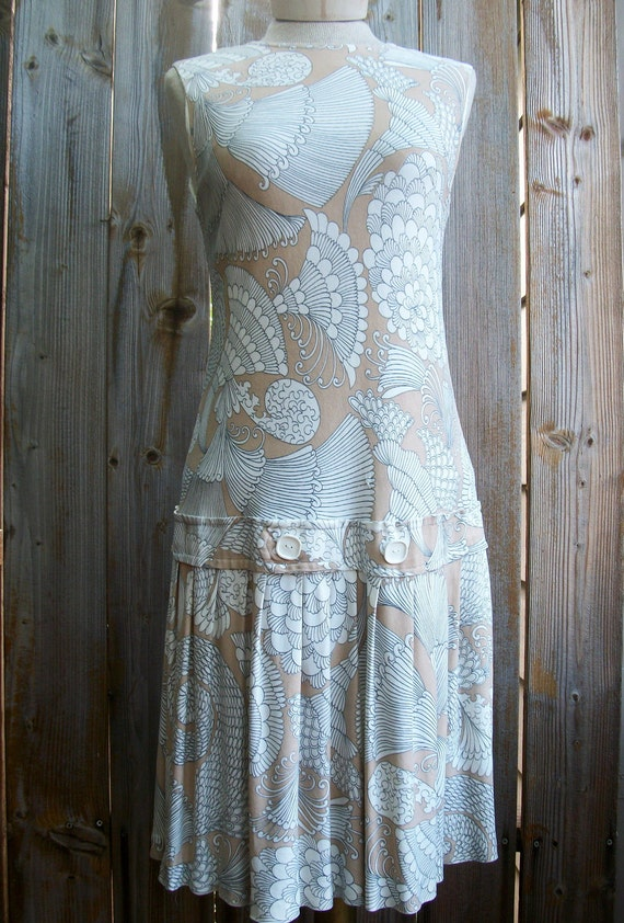 Women's vintage drop waist dress, sleeveless with pleated skirt, taupe, nude,with black and white print, 1960's.