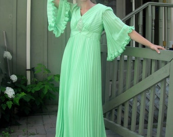 Vintage mint green maxi dress 1970s Halloween costume accordion pleats, rhinestone beads and bell sleeves.