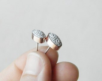 Small oval stud earrings. Porous polymer clay pebbles in copper and silver.