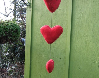 Heart Mobile - Fleece embroidered with sequins and bugle beads.