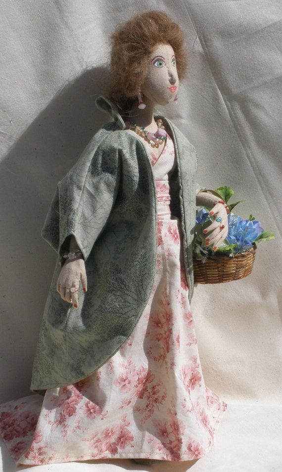 Margaret, a cloth doll, 17 inches tall, gathering flowers in handbasket