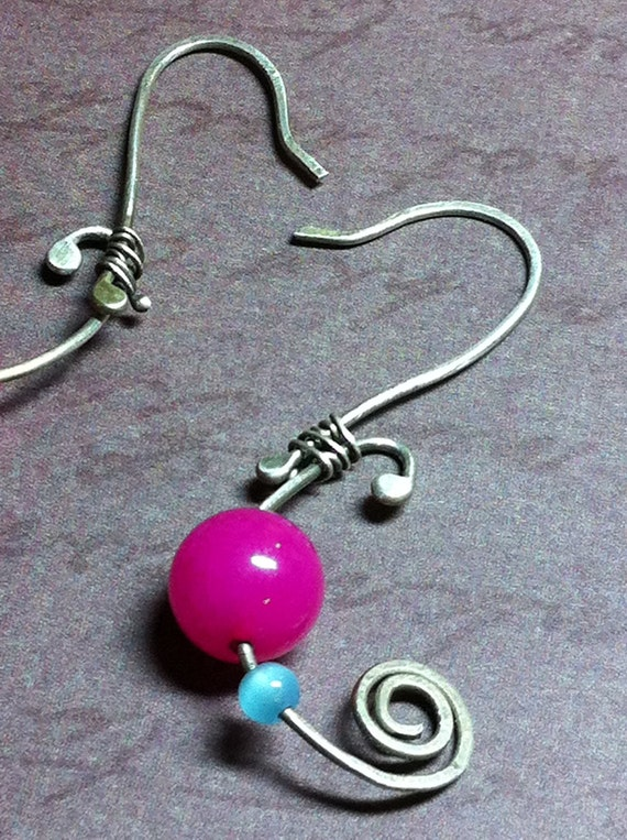 Modern earrings, with bright hot colored beads,  on sterling silver frames and earwires. Ooak
