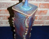 Tall square lidded jar
