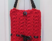 KNITTED, Red Messenger, handbag/purse, in  a lacey sea shell stitch, with faux black leather straps