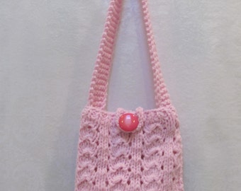 SALE ITEM, Hand Knitted Handbag: A lovely, pink knitted purse/handbag ,fully lined with a cellphone pocket, snap and button closure