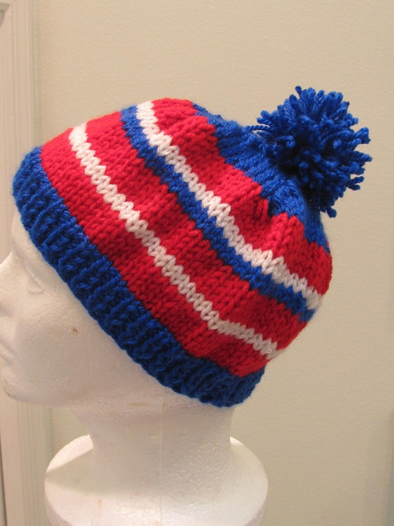 BOY'S KNITTED HAT: beanie styled hat, hand knitted, red, white and blue, with a pompom