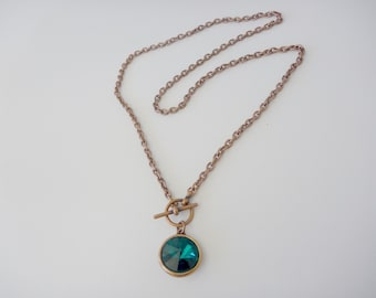 Swarovski Pendant Necklace - A round Emerald Green Swarovski Rivoli Crystal with an antiqued  copper Toggle and oval link chain