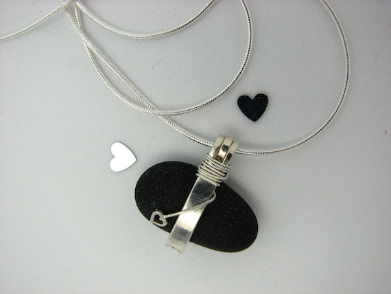 Black Pebble Adorned in Sterling Silver and a Heart. LAKE STONE
