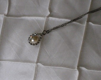 Vintage necklace with silver chain.  Costume jewelry.  Pearl.