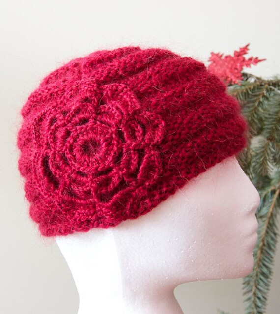Red hand knit hat with crocheted flower