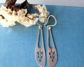 Sterling silver flower long earrings.