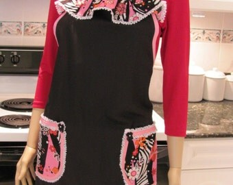 SEXY MODERN APRON: Full Apron, Jazzy  black  with ruffled hemline, pockets, ruffled neck in a hot pink and red print