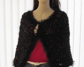 HAND KNITTED, BLACK Cape : Wrap/cape, red, black and gold imported yarn,very elegant with a removable brooch