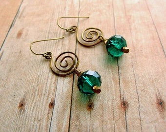 Emerald green crystal earrings with bronze wire spirals // crystal jewelry