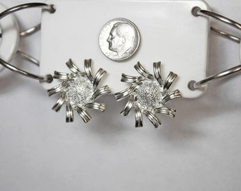 Vintage CORO Silver Tone Clip Earrings In a Starburst or Flower Design