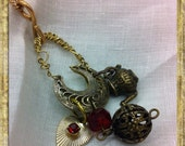 Upcycled necklace with vintage teapot charm and heart charm