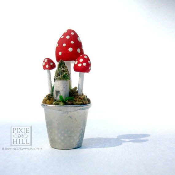 A Fairy Garden - Moss, Mushrooms, and Tiny Faerie House Goodness in a thimble.