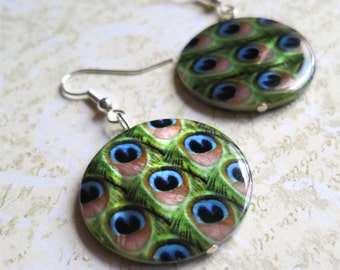 Peacock feather earrings on round shell. HALF PRICE SALE. Take 50% off.
