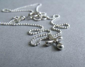 Teeny tiny cross with beaded chain.