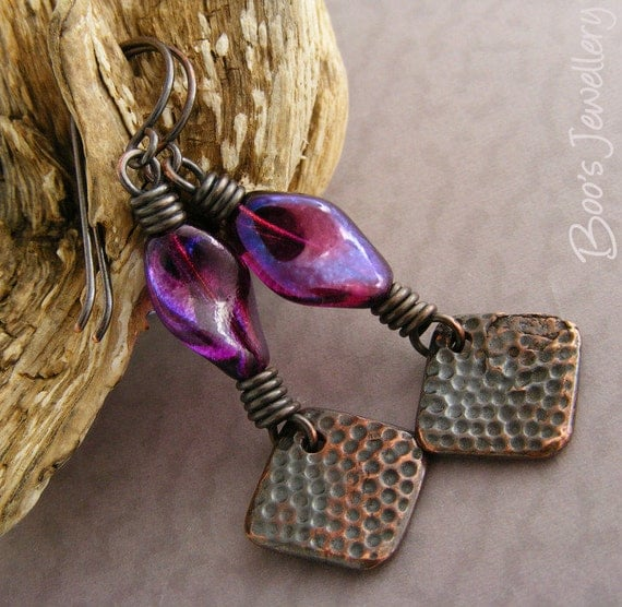 Oxed copper earrings featuring twisted purple glass beads with dimpled copper charms