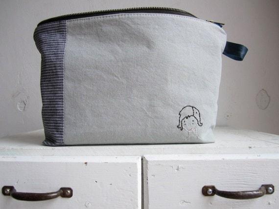 Short haired girl a zipper pouch