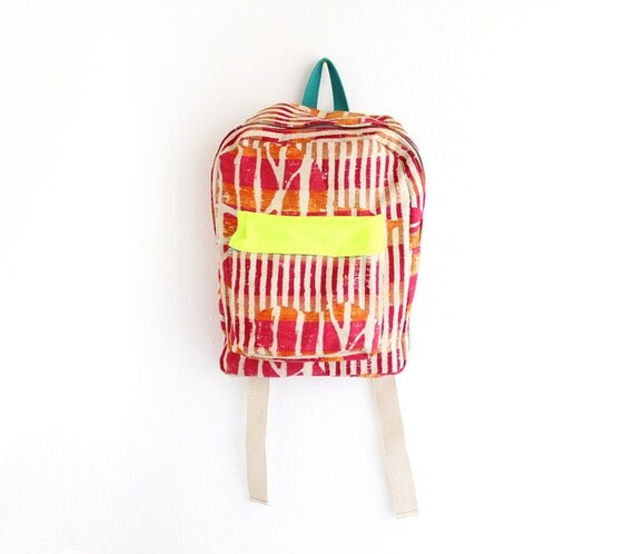 Orange and magenta abstract burlap backpack with neon yellow pouch