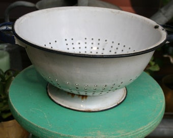 vintage white  enamel colander use as a fruit bowl or fill with plants