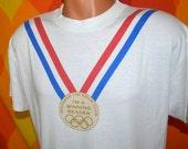 vintage t-shirt 80s OLYMPICS rings whitaker school winning reader gold medal tee shirt Large