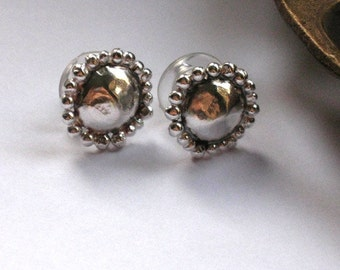 Small round metalwork silver ear studs