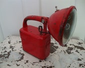 vintage battery powered camp or flashlight....striking red color