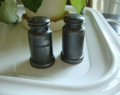 pair of vintage pewter etched design salt and pepper shakers