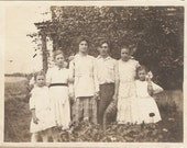 antique photo of a victorian family out in the garden - great hair and fashions - super vintage photo