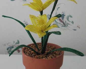 Handmade french beaded flowers planted daffodils in clay pot